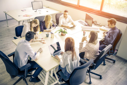 Meeting of young business people in a modern office - Start up company, workers brainstorming