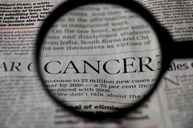 słowo cancer w gazecie